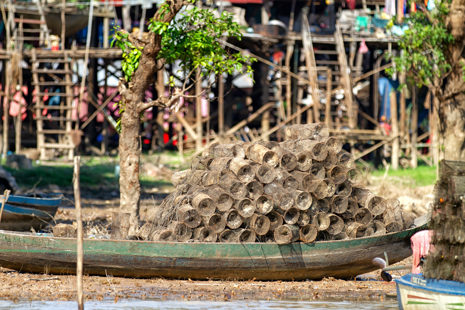 Many small fishing traps on a wood boat in Kampong Phluk on Tonle Sap lake waiting to be used for fishing